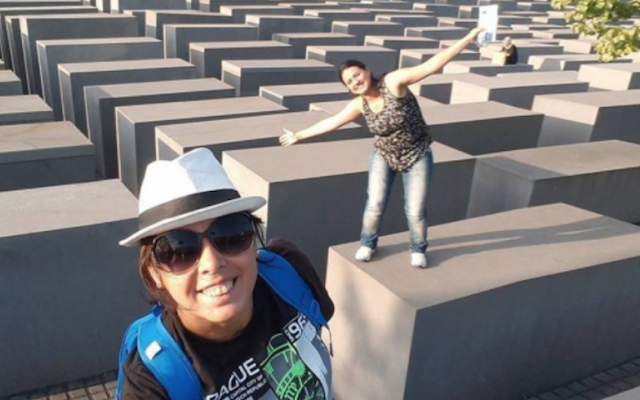 This picture shows a woman balancing on top of a memorial to Holocaust victims. (Screenshot from Yolocaust)
