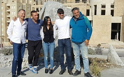 Coldplay's Chris Martin (second from left), an unidentified woman, Coldplay guitarist Jonny Buckland and producer Ilan Factor in a photograph sent out in late February (Courtesy Nidar Oz Communications)
