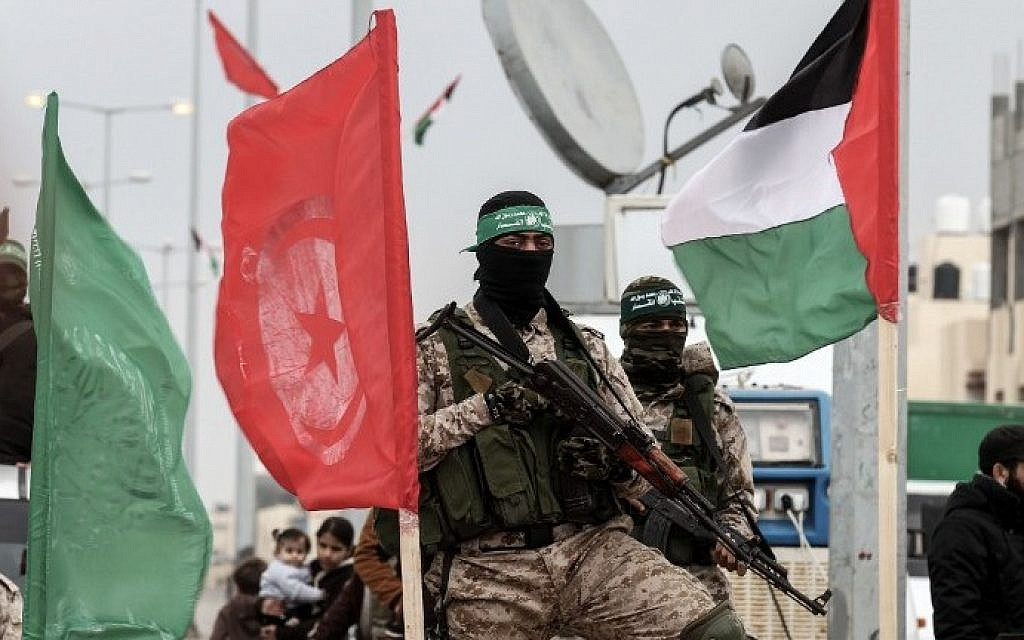 Members of Hamas's military wing the Izz ad-Din al-Qassam Brigade attending a memorial in the southern Gaza Strip city of Rafah on January 31, 2017. (AFP Photo/Said Khatib)
