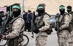 Members of the Hamas terror group's military wing  at a memorial in the southern Gaza Strip town of Rafah on January 31, 2017, for Mohamed Zouari, a 49-year-old Tunisian engineer and drone expert, who was killed at the wheel of his car outside his house in Tunisia in December 2016.  (AFP/Said Khatib)
