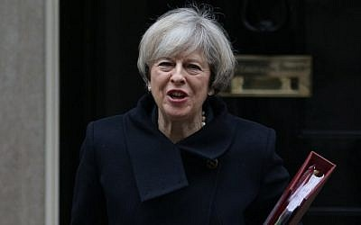 British Prime Minister Theresa May leaves 10 Downing street for the weekly Prime Minister's Questions session at the House of Commons in central London, February 1, 2017. (AFP/Daniel LEAL-OLIVAS)