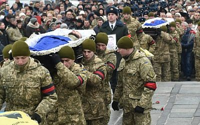 Servicemen carry coffins with the bodies of Ukrainian soldiers who died during fighting in the eastern Ukrainian town of Avdiivka, during a mourning ceremony in Independence Square in Kiev on February 1, 2017. (Sergei Supinsky/AFP)