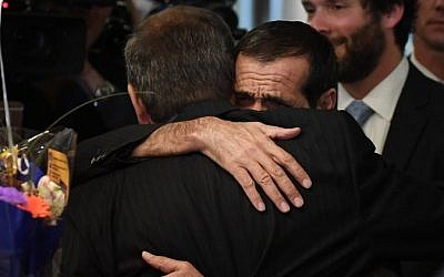 Ali Vayeghan (R) hugs his brother Hossein upon arrival at Los Angeles International Airport after he was previously barred entry and deported from the United States under President Trump's travel ban, in Los Angeles, California on February 2, 2017 (AFP PHOTO / Mark RALSTON)