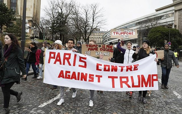Anti-Trump protesters hold a banner reading 'Paris against Trump' during a demonstration against Trump's policies in Paris, February 4, 2017. (AFP/THOMAS SAMSON)