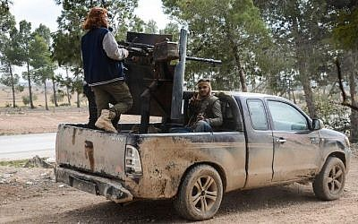 Fighters from the Free Syrian Army in an armoured pickup truck near the town of Bizaah northeast of the city of Al-Bab, some 30 kilometers from the Syrian city of Aleppo, on February 4, 2017. (AFP Photo/Nazeer al-Khatib)