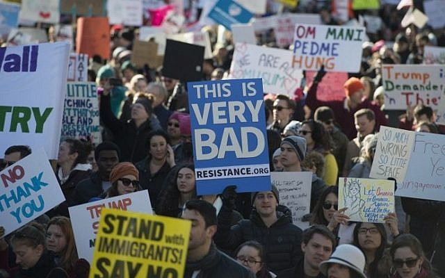 Protesters march on Pennsylvania Avenue while protesting against US President Donald Trump's recent action on refugees entering the US on February 4, 2017, in Washington, DC. (AFP PHOTO / MOLLY RILEY)