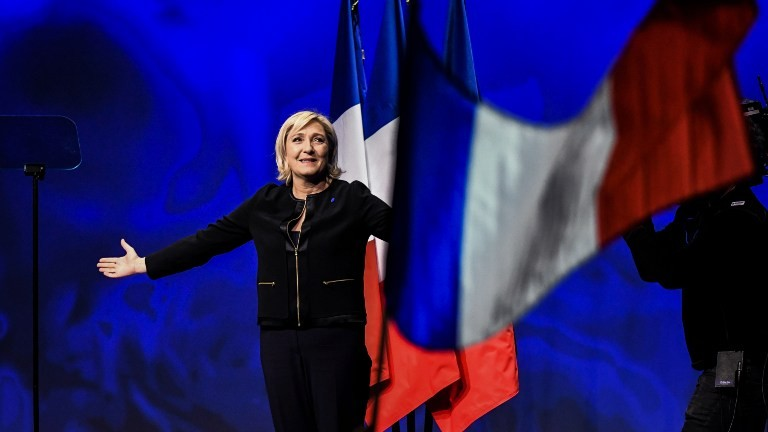 Head of the French far-right party Front national (FN) and presidential candidate Marine Le Pen arrives on stage to give a speech, on February 5, 2017. (AFP Photo/Jeff Pachoud)