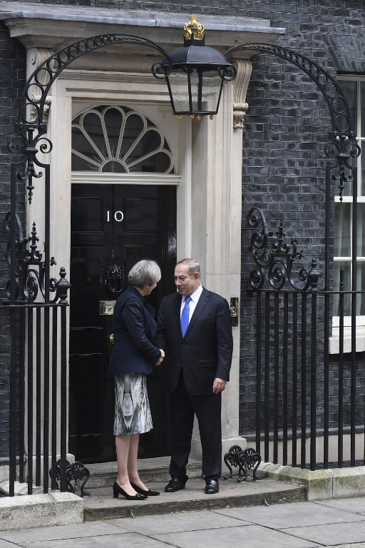 British Prime Minister Theresa May shakes hands with Prime Minister Benjamin Netanyahu ahead of their meeting at 10 Downing Street in London on February 6, 2017. (AFP PHOTO/Chris J Ratcliffe)