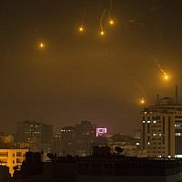 Illustrative: Flares fired by Israeli forces to check the border are seen over Gaza City on February 6, 2017. (Mahmud Hams/AFP)