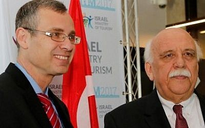 Turkish Minister Of Culture and Tourism Nabi Avci (R) and Israeli Tourism Minister Yariv Levin (L) shake hands during their meeting at the Israeli tourism conference in Tel Aviv on February 7, 2017. (AFP/Gil Cohen-Magen)