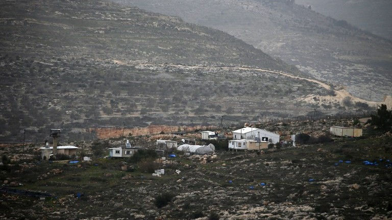A picture taken on February 8, 2017 from the Palestinian West Bank village of Yasuf shows the Israeli wildcat outpost of Kfar Tapuah West, located near the settlement of Kfar Tapuah. (AFP Photo/Jaafar Ashtiyeh)