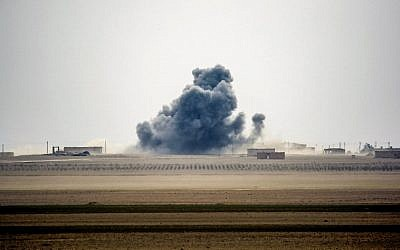 Illustrative: Smoke rises near the village of Bir Fawaz, north of Raqqa, as members of the Syrian Democratic Forces, made up of US-backed Kurdish and Arab fighters, advance during their offensive towards the Islamic State group's Syrian stronghold as part of the third phase to retake the city and its surroundings, February 8, 2017. (AFP/DELIL SOULEIMAN)
