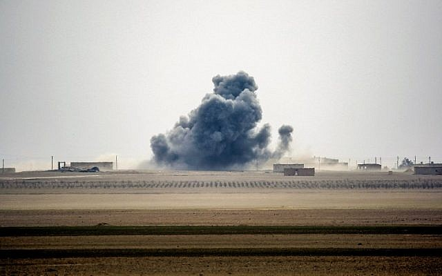 Smoke rises near the village of Bir Fawaz, north of Raqa, as members of the Syrian Democratic Forces, made up of US-backed Kurdish and Arab fighters, advance during their offensive towards the Islamic State group's Syrian stronghold as part of the third phase to retake the city and its surroundings, February 8, 2017. (AFP/DELIL SOULEIMAN)
