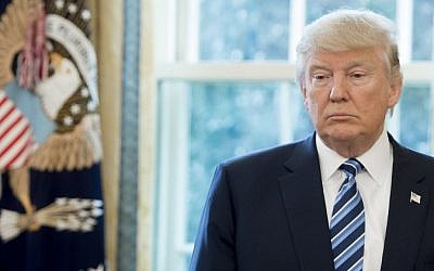 US President Donald Trump stands in the Oval Office of the White House in Washington, DC, February 9, 2017. (AFP/Saul Loeb)