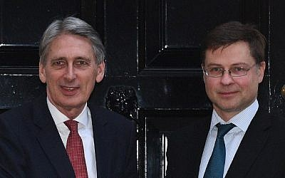 British Chancellor of the Exchequer Philip Hammond (L) is pictured with Vice President of the European Commission Valdis Dombrovskis outside 11 Downing Street in central London on February 9, 2017. (Justin Tallis/AFP)