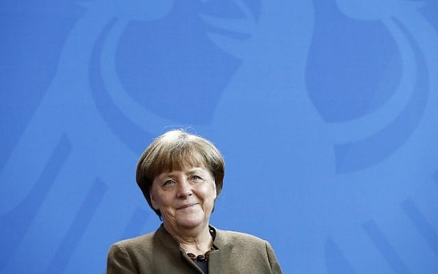 German Chancellor Angela Merkel smiles during a meeting with the new president of Germany's Upper House of Parliament and Rhineland-Palatinate State Premier Malu Dreyer (not pictured) in Berlin on February 10, 2017. (AFP Photo/Odd Andersen)