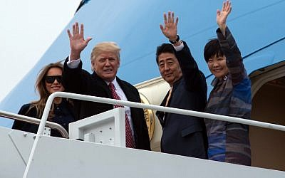 US First Lady Melania Trump, US President Donald Trump, Japanese Prime Minister Shinzo Abe and his wife Akie Abe board Air Force One at Andrews Air Force Base in Maryland as they depart for Trump's Mar-a-Lago resort in Florida for the weekend on February 10, 2017. (AFP PHOTO / NICHOLAS KAMM)