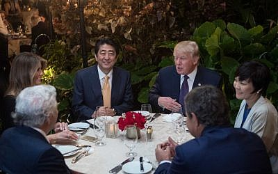 US President Donald Trump, center, Japanese Prime Minister Shinzo Abe (2nd left), his wife Akie Abe (right), US First Lady Melania Trump (Left) and Robert Kraft (foreground), sit down for dinner at Trump's Mar-a-Lago resort on February 10, 2017. (AFP / NICHOLAS KAMM)
