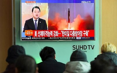 Illustrative: People watch the news showing file footage of North Korea's missile launch at a railway station in Seoul, South Korea on February 12, 2017. (Jung Yeon-Je/AFP)