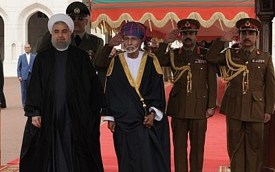 Oman's Sultan Qaboos bin Said (C) and Iranian President Hassan Rouhani review the honour guard upon the later arrival in Muscat on February 15, 2017. (AFP Photo/Mohammed Mahjoub)