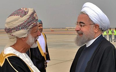 Omani Foreign Minister Yussef bin Alawi bin Abdullah (L) greets Iranian President Hassan Rouhani upon the latter arrival in Muscat on February 15, 2017. (AFP/Omani News Agency/Handout)