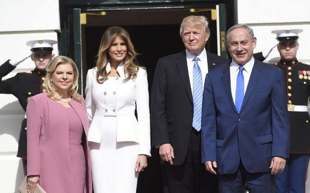 US President Donald Trump and First Lady Melania Trump welcome Israeli Prime Minister Benjamin Netanyahu and his wife, Sara, as they arrive at the White House in Washington, DC, February 15, 2017. (AFP PHOTO / SAUL LOEB)
