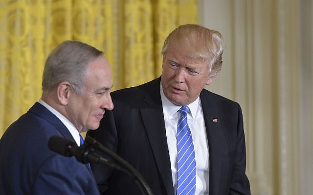 US President Donald Trump (R) welcomes Israeli Prime Minister Benjamin Netanyahu during a joint press conference at the White House in Washington, DC, February 15, 2017. (AFP/Mandel Ngan)