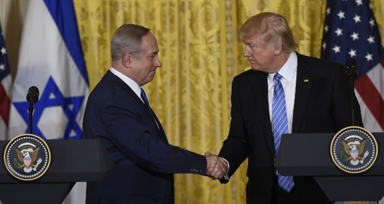 US President Donald Trump and Prime Minister Benjamin Netanyahu shake hands during a joint press conference in the East Room of the White House in Washington, DC, February 15, 2017. (AFP PHOTO / SAUL LOEB)