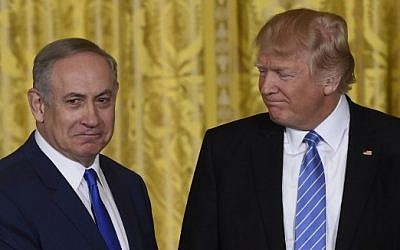 US President Donald Trump, right, and Israeli Prime Minister Benjamin Netanyahu shake hands during a joint press conference in the East Room of the White House in Washington, DC, February 15, 2017. (AFP/Saul Loeb)