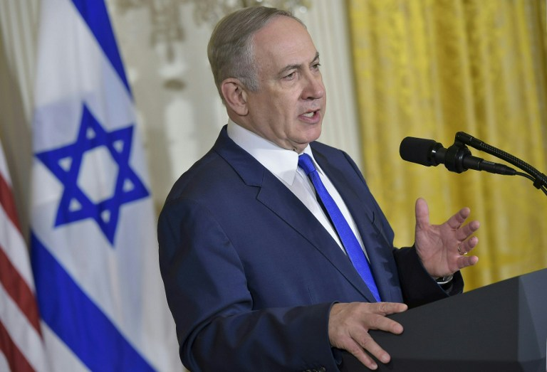 Prime Minister Benjamin Netanyahu makes a point during a joint press conference with US President Donald Trump at the White House in Washington, DC February 15, 2017 (AFP PHOTO / MANDEL NGAN)