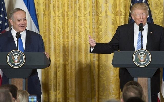 US President Donald Trump, right, and Prime Minister Benjamin Netanyahu hold a joint press conference in the East Room of the White House in Washington, DC, February 15, 2017. (AFP/SAUL LOEB)