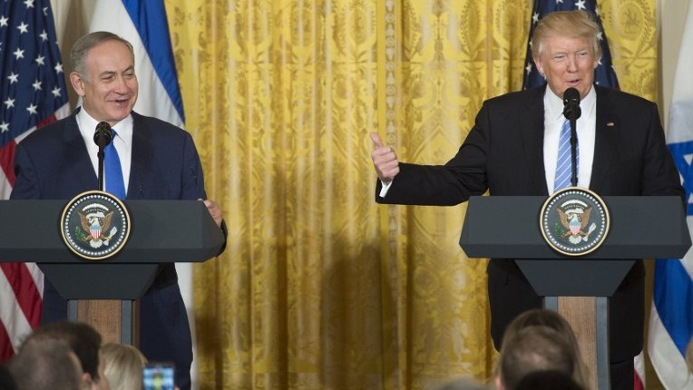 US President Donald Trump, right, and Israeli Prime Minister Benjamin Netanyahu hold a joint press conference in the East Room of the White House in Washington, DC, February 15, 2017. (AFP/SAUL LOEB)
