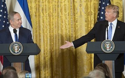 US President Donald Trump, right, and Israeli Prime Minister Benjamin Netanyahu hold a joint press conference in the East Room of the White House in Washington, DC, February 15, 2017. (AFP/ SAUL LOEB)