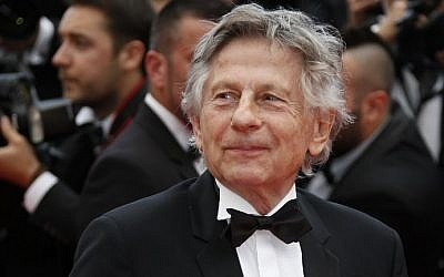 """This file photo taken on May 17, 2014 shows French director Roman Polanski posing as he arrives for the screening of the film """"Saint-Laurent"""" at the 67th edition of the Cannes Film Festival in Cannes, France. (AFP Photo/Valery Hache)"""