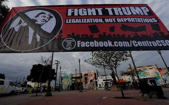 An anti-Trump banner outside the J&F Ice Cream store, which closed for the day in solidarity with the 'Day Without Immigrants' nationwide protests, in Los Angeles, California, on February 16, 2017. Scores of restaurants across the US shut down as part of the opposition to Donald Trump's treatment of immigrants. (AFP PHOTO/Mark RALSTON)
