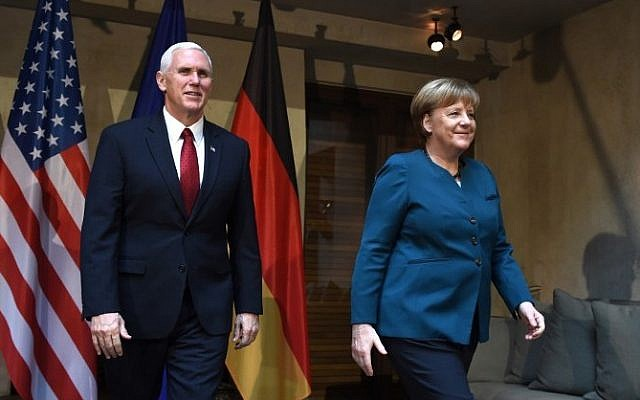 US Vice President Mike Pence (L) and German Chancellor Angela Merkel leave the room after a photo call prior to a bilateral meeting on the 2nd day of the 53rd Munich Security Conference (MSC) at the Bayerischer Hof hotel in Munich, southern Germany, on February 18, 2017. (AFP PHOTO / Christof STACHE)