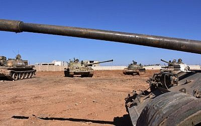 Syrian army tanks are positioned on the eastern outskirts of the northern Syrian city of Aleppo on February 17, 2017. (AFP Photo/George Ourfalian)