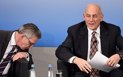 German Interior Minister Thomas de Maiziere (L) looks down beside of US Secretary of Homeland Security John Kelly (R) during a talk on the second day of the 53rd Munich Security Conference at the Bayerischer Hof hotel in Munich, southern Germany, on February 18, 2017. (AFP/Christof Stache)