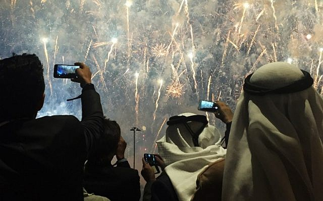 People take pictures of fireworks during the inauguration ceremony of the Trump International Golf Club in Dubai on February 18, 2017. (AFP PHOTO/Natacha YAZBECK)