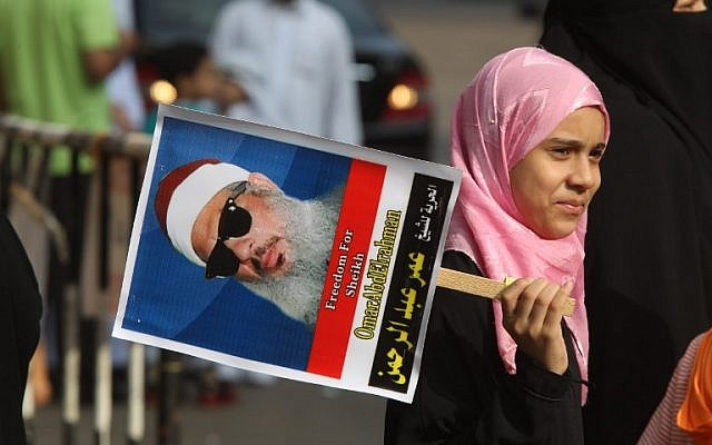 An Egyptian girl  holds a portrait of cleric Sheikh Omar Abdel Rahman during a sit-in to call for his release in front of the US Embassy in Cairo on August 30, 2011. (AFP PHOTO/KHALED DESOUKI)