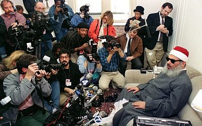 Sheikh Omar Abdel Rahman, the blind spiritual leader of Egypt's largest Islamic extremist fundamentalist group Gamaa Islamiya, faces photographers and reporters during a news conference in Jersey City on April 6, 1993. (AFP/Hai Do)