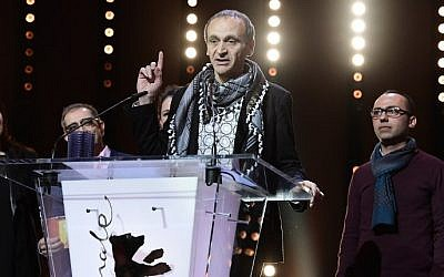 Palestinian director Raed Andoni speaks after beeing awarded with Glashuette Original Documentary Award during the Award Ceremony of the 67th Berlinale film festival in Berlin, February 18, 2017.  (AFP/Tobias SCHWARZ)