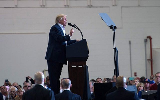 US President Donald Trump addresses a rally at the Orlando Melbourne International Airport in Melbourne, Florida, February 18, 2017. (AFP/NICHOLAS KAMM)