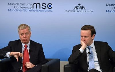 US Senator Lindsey Graham (L) gestures beside his compatriot US Senator Christopher Murphy (R) during a panel talk at the third day of the 53rd Munich Security Conference (MSC) at the Bayerischer Hof hotel in Munich, southern Germany, on February 19, 2017 (AFP PHOTO / Christof STACHE)