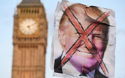 An anti-Trump placard is pictured near the Houses of Parliament during an anti-Trump demonstration in London on February 20, 2017, as parliament debates whether or not to allow Donald Trump a state visit. (AFP Photo/Justin Tallis)