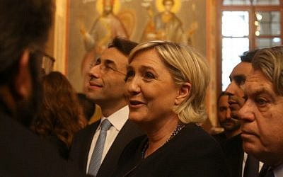 France's far-right presidential candidate Marine Le Pen (C) and French MP Gilbert Collard (R) listen to a priest as they visit the Saint George Greek Orthodox Cathedral in downtown Beirut on February 20, 2017. (AFP Photo/Patrick Baz)