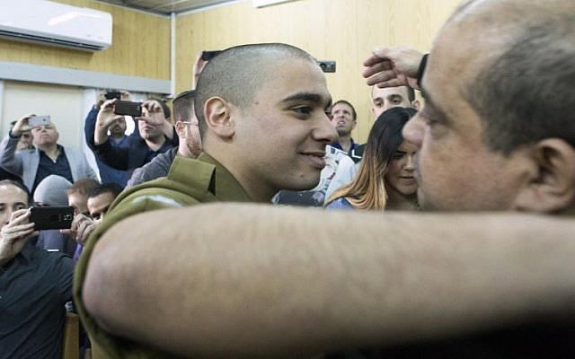 IDF soldier Elor Azaria, convicted on the manslaughter of a wounded Palestinian, at the start of his sentencing hearing in a military court in Tel Aviv, February 21, 2017. (AFP/POOL/ JIM HOLLANDER)