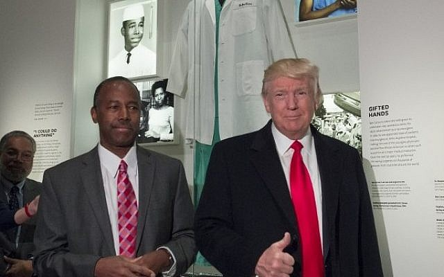 US President Donald Trump alongside Dr. Ben Carson, his nominee for Secretary of Housing and Urban Development, as they tour an exhibit about Carson at the Smithsonian National Museum of African American History and Culture in Washington, DC, February 21, 2017. (AFP PHOTO / SAUL LOEB)
