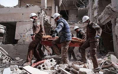 Illustrative: Syrian civil defense volunteers, known as the White Helmets, search for survivors following a reported government airstrike on the rebel-held neighborhood of Tishrin, on the northeastern outskirts of the capital Damascus, on February 22, 2017. (Msallam Abdalbaset/AFP)