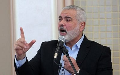 Former Hamas prime minister in the Gaza Strip Ismail Haniya speaks in the presence of the new leader of Hamas in the Gaza Strip, during the opening of a new mosque in Rafah in the southern Gaza Strip on February 24, 2017. (AFP PHOTO / SAID KHATIB)